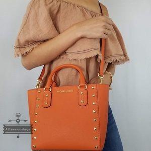 ead263a6ea3db6 Michael Kors Bags - Michael Kors Sandrine Small crossbody Tangerine